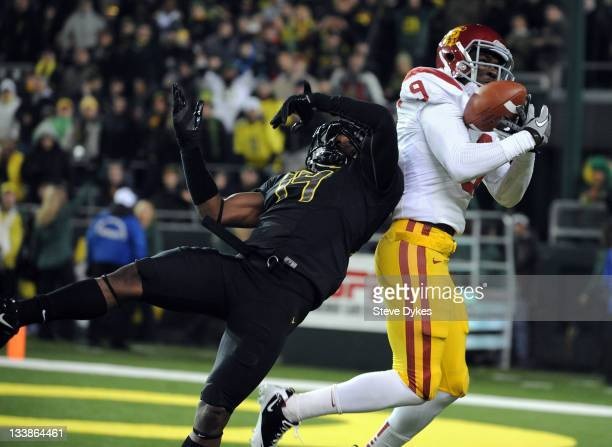 Cornerback Ifo EkpreOlomu of the Oregon Ducks goes up in a vain attempt to knock down a pass intended for wide receiver Marqise Lee of the USC...