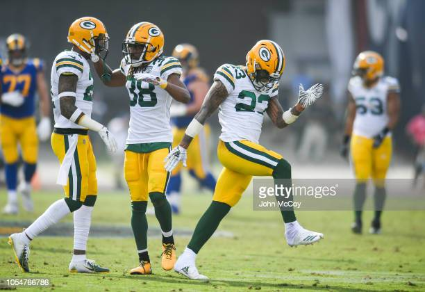 Cornerback Jaire Alexander of the Green Bay Packers celebrates after deflecting a pass against the Los Angeles Rams at Los Angeles Memorial Coliseum...