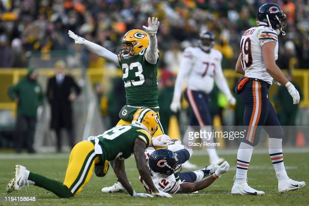 Cornerback Jaire Alexander of the Green Bay Packers reacts to a defensive stop on forth down incomplete pass to wide receiver Allen Robinson of the...