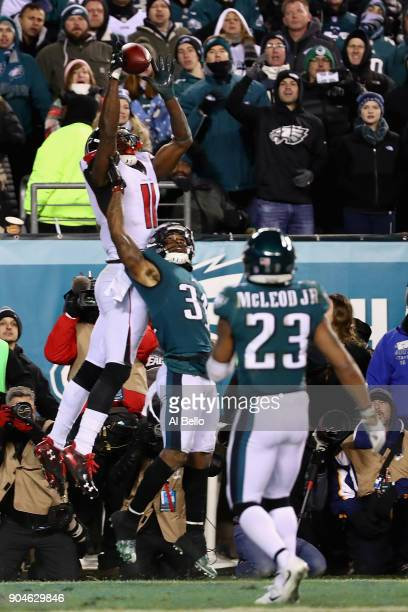 Cornerback Jalen Mills of the Philadelphia Eagles breaks up a pass intended for wide receiver Julio Jones of the Atlanta Falcons at the end of the...