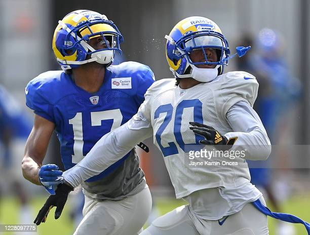 Cornerback Jalen Ramsey defends a pass for wide receiver Robert Woods of the Los Angeles Rams during training camp on August 18, 2020 at the Rams...