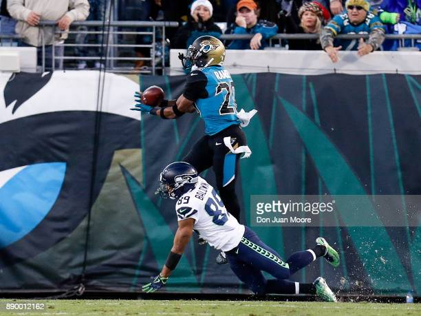 Cornerback Jalen Ramsey of the Jacksonville Jaguars makes interception over Wide Receiver Doug Baldwin of the Seattle Seahawks in the endzone during...