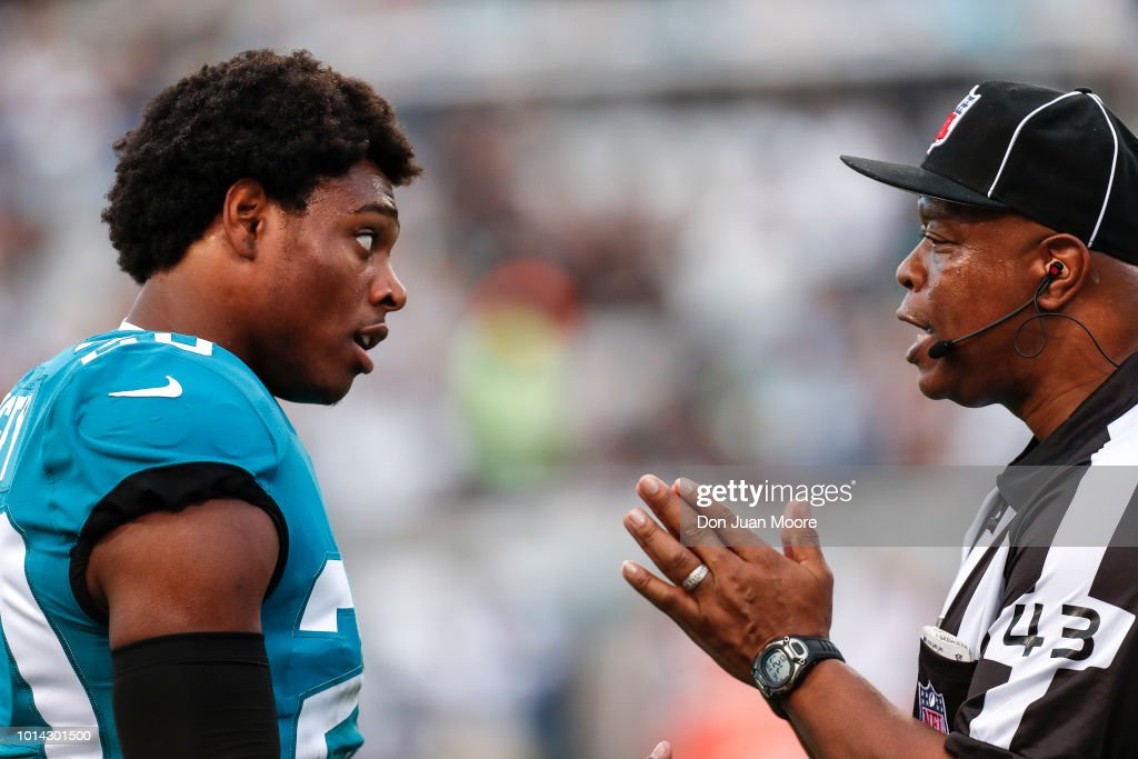 Cornerback Jalen Ramsey #20 of the Jacksonville Jaguars talks with Field Judge Terry Brown about a play during a preseason game against the New Orleans Saints at TIAA Bank Field on August 9, 2018 in Jacksonville, Florida. The Saints defeated the Jaguars 24 to 20.