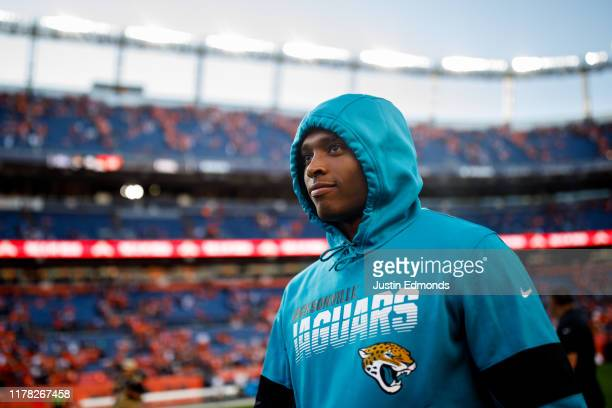 Cornerback Jalen Ramsey of the Jacksonville Jaguars walks on the field against the Denver Broncos after the game at Empower Field at Mile High on...