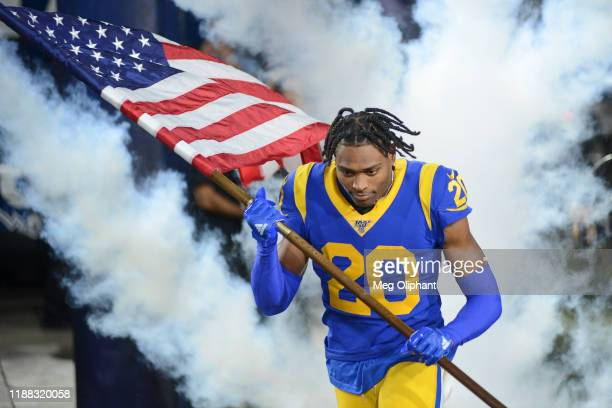 Cornerback Jalen Ramsey of the Los Angeles Rams runs onto the field for the game against the Chicago Bears at Los Angeles Memorial Coliseum on...