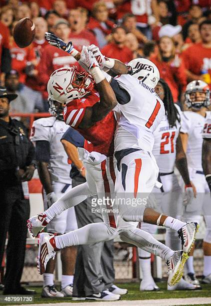 Cornerback Jalen Thompson of the South Alabama Jaguars knocks the ball away from wide receiver Stanley Morgan Jr #8 of the Nebraska Cornhuskers...