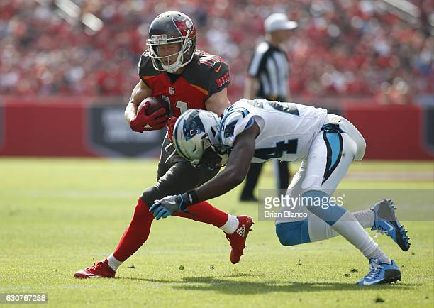 Cornerback James Bradberry of the Carolina Panthers stops wide receiver Adam Humphries of the Tampa Bay Buccaneers to hold him to a gain of three...