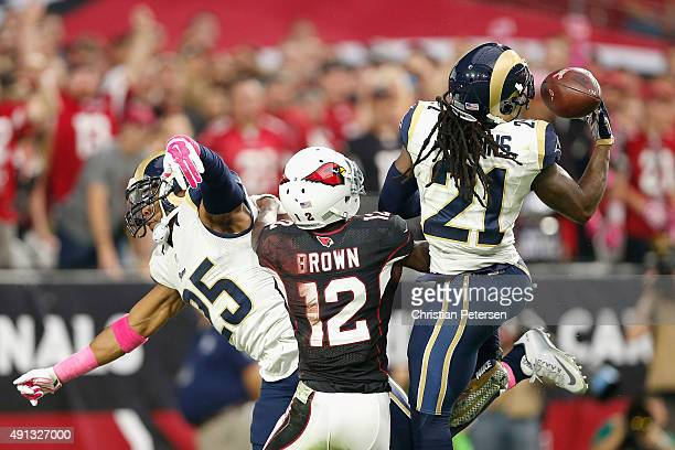 Cornerback Janoris Jenkins of the St Louis Rams intercepts a pass intended for wide receiver John Brown of the Arizona Cardinals while strong safety...