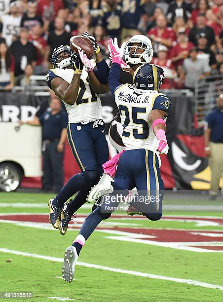 Cornerback Janoris Jenkins of the St Louis Rams intercepts a pass intended for wide receiver John Brown of the Arizona Cardinals while safety TJ...