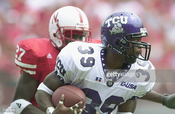 Cornerback Jason Goss of the Texas Christian University Horned Frogs runs back an interception during the NCAA football game against the Nebraska...