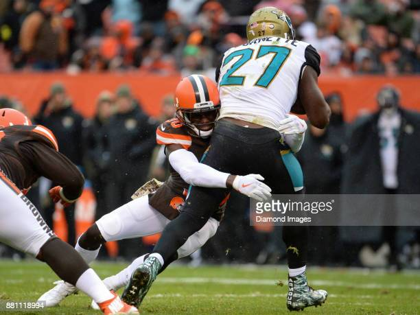 Cornerback Jason McCourty of the Cleveland Browns tackles running back Leonard Fournette of the Jacksonville Jaguars in the second quarter of a game...
