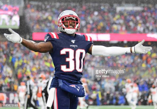 Cornerback Jason McCourty of the New England Patriots celebrates a touchdown in the first quarter of the game against the Cleveland Browns at...