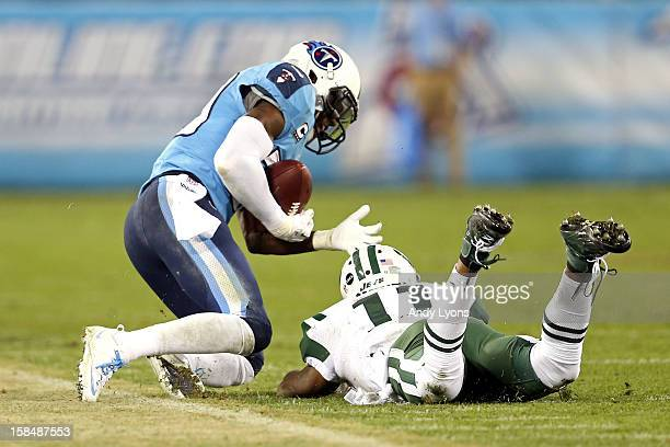 Cornerback Jason McCourty of the Tennessee Titans intercepts a ball intended for Wide receiver Jeremy Kerley of the New York Jets in the third...