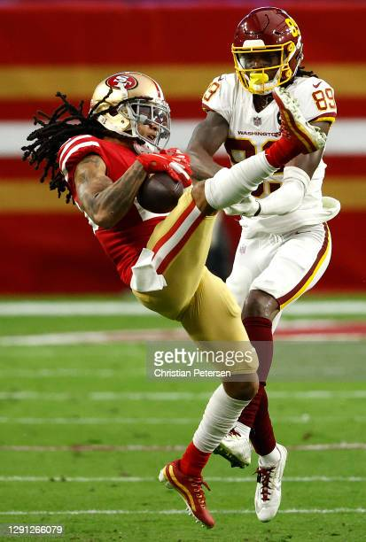 Cornerback Jason Verrett of the San Francisco 49ers intercepts a pass intended for wide receiver Cam Sims of the Washington Football Team during the...