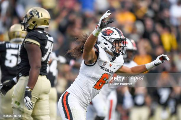 Cornerback Jay Irvine of the Oregon State Beavers begins to celebrate a 41-34 win after the Colorado Buffaloes failed to convert on fourth down in...