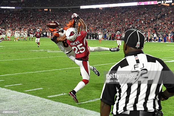 Cornerback Jerraud Powers of the Arizona Cardinals breaks up a pass intended for wide receiver Marvin Jones of the Cincinnati Bengals during the...
