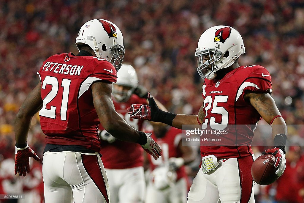 Cornerback Jerraud Powers #25 of the Arizona Cardinals celebrates with Patrick Peterson #22 after Powers scored on a seven yard fumble recovery during the NFL game against the Green Bay Packers at the University of Phoenix Stadium on December 27, 2015 in Glendale, Arizona. The Cardinals defeated the Packers 38-8.
