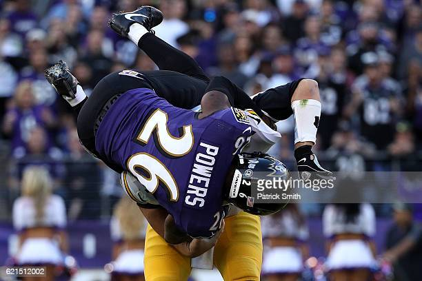 Cornerback Jerraud Powers of the Baltimore Ravens attempts to sack quarterback Ben Roethlisberger of the Pittsburgh Steelers in the fourth quarter at...