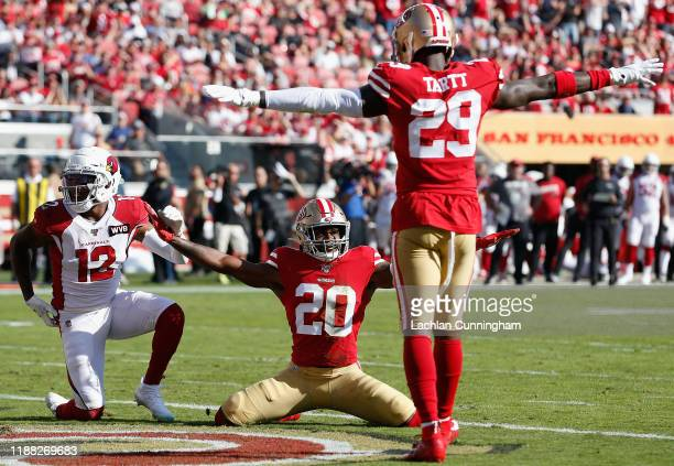 Cornerback Jimmie Ward and safety Jaquiski Tartt of the San Francisco 49ers react after breaking up a pass intended for wide receiver Pharoh Cooper...