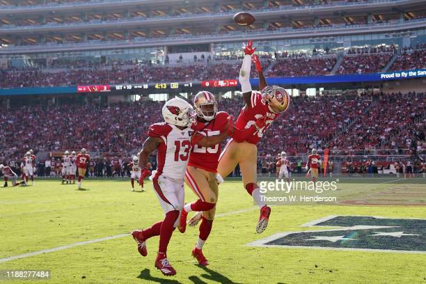 Cornerback Jimmie Ward of the San Francisco 49ers makes a defensive play over wide receiver Christian Kirk of the Arizona Cardinals during the first...
