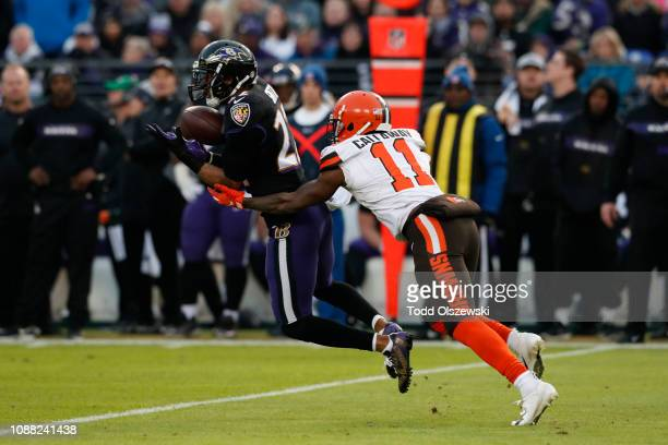 Cornerback Jimmy Smith of the Baltimore Ravens catches an interception in the first quarter against the Cleveland Browns at M&T Bank Stadium on...