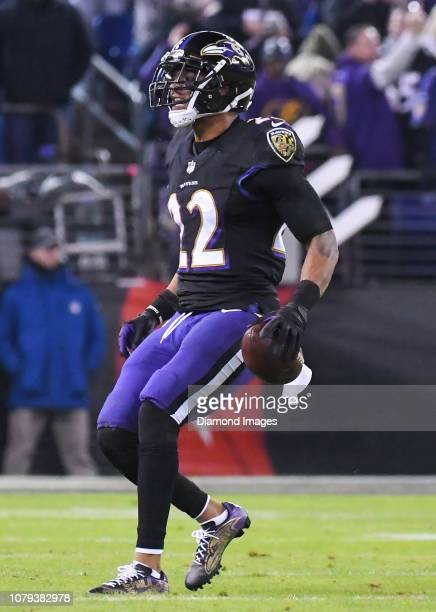 Cornerback Jimmy Smith of the Baltimore Ravens celebrates after intercepting a pass in the second quarter of a game against the Cleveland Browns on...