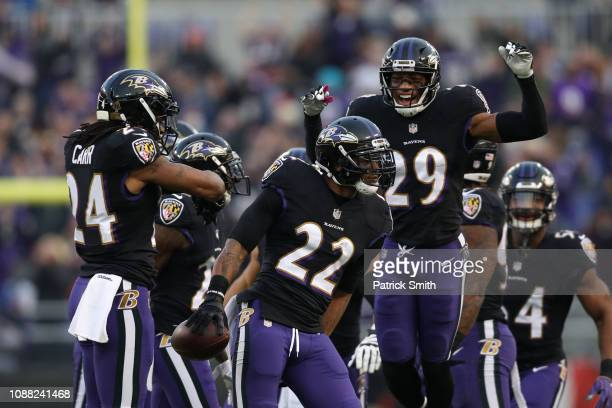 Cornerback Jimmy Smith of the Baltimore Ravens celebrates with teammates after an interception in the first quarter against the Cleveland Browns at...