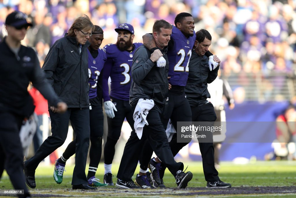 Cornerback Jimmy Smith #22 of the Baltimore Ravens is helped off the field by medical staff in the second quarter against the Detroit Lions at M&T Bank Stadium on December 3, 2017 in Baltimore, Maryland.