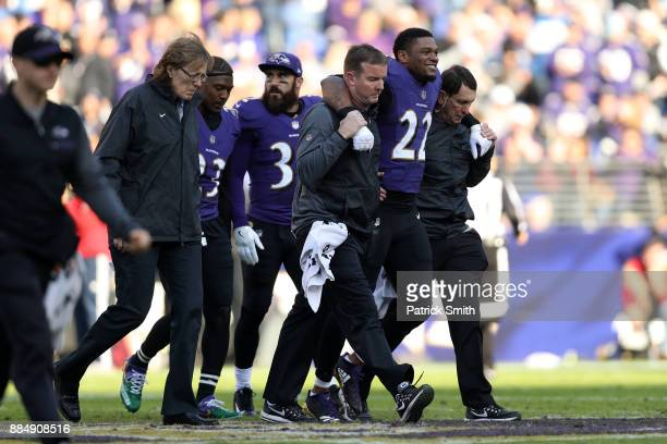 Cornerback Jimmy Smith of the Baltimore Ravens is helped off the field by medical staff in the second quarter against the Detroit Lions at M&T Bank...