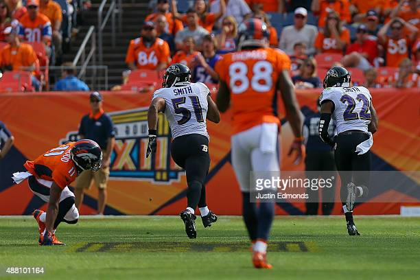Cornerback Jimmy Smith of the Baltimore Ravens returns an interception for a touchdown after breaking up a pass intended for wide receiver Jordan...