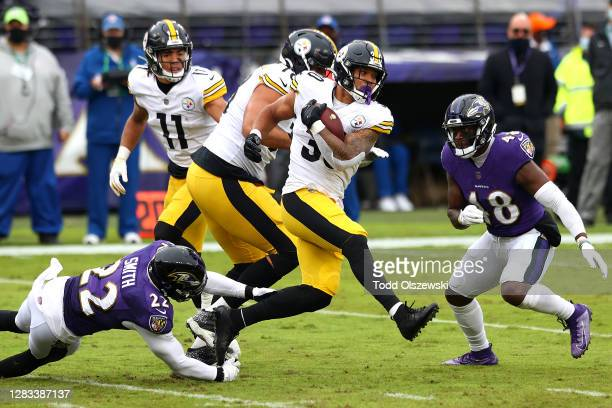 Cornerback Jimmy Smith of the Baltimore Ravens tackles running back James Conner of the Pittsburgh Steelers in the second half at M&T Bank Stadium on...