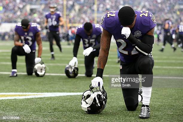 Cornerback Jimmy Smith of the Baltimore Ravens takes a moment before a game against the Seattle Seahawks at M&T Bank Stadium on December 13, 2015 in...