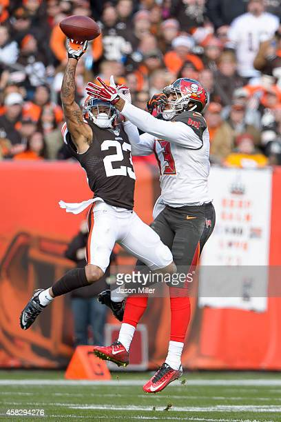 Cornerback Joe Haden of the Cleveland Browns breaks up a pass intended for wide receiver Mike Evans of the Tampa Bay Buccaneers during the first half...