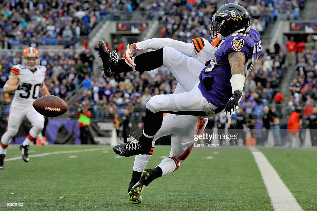 Cornerback Joe Haden #23 of the Cleveland Browns breaks up a pass intended for wide receiver Steve Smith #89 of the Baltimore Ravens in the fourth quarter of a game at M&T Bank Stadium on December 28, 2014 in Baltimore, Maryland.