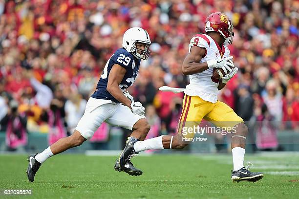 Cornerback John Reid of the Penn State Nittany Lions pursues wide receiver JuJu SmithSchuster of the USC Trojans during the 2017 Rose Bowl Game...