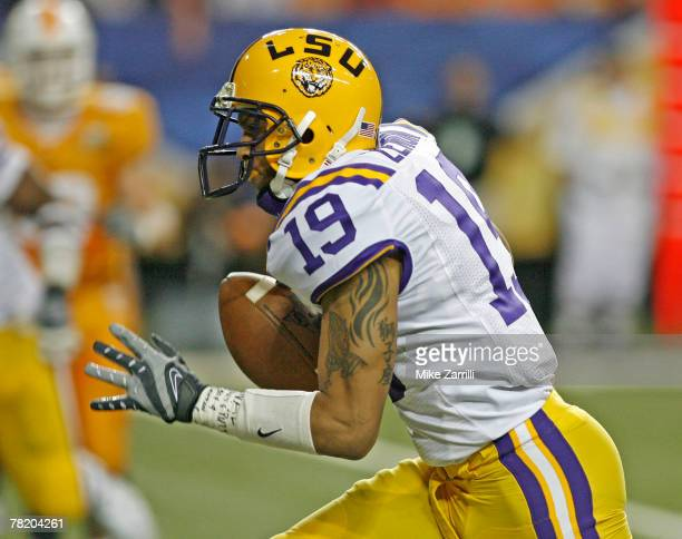 Cornerback Jonathan Zenon of the LSU Tigers runs a fourth quarter interception back for a go ahead touchdown during the SEC Championship game against...