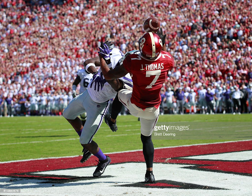 Cornerback Jordan Thomas #7 of the Oklahoma Sooners breaks up and tries to catch a pass intended for wide receiver Byron Pringle #9 of the Kansas State Wildcats October 15, 2016 at Gaylord Family-Oklahoma Memorial Stadium in Norman, Oklahoma.