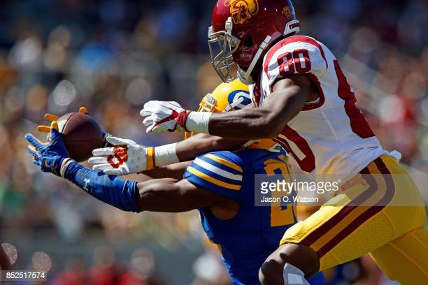 Cornerback Josh Drayden of the California Golden Bears intercepts a pass intended for wide receiver Deontay Burnett of the USC Trojans during the...