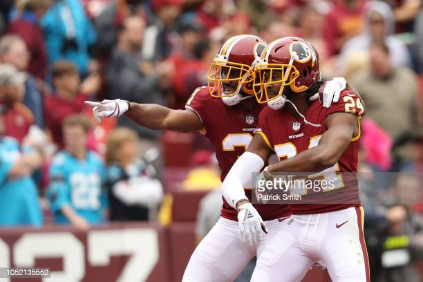 Cornerback Josh Norman and cornerback Fabian Moreau of the Washington Redskins react after a play in the second quarter against the Carolina Panthers...