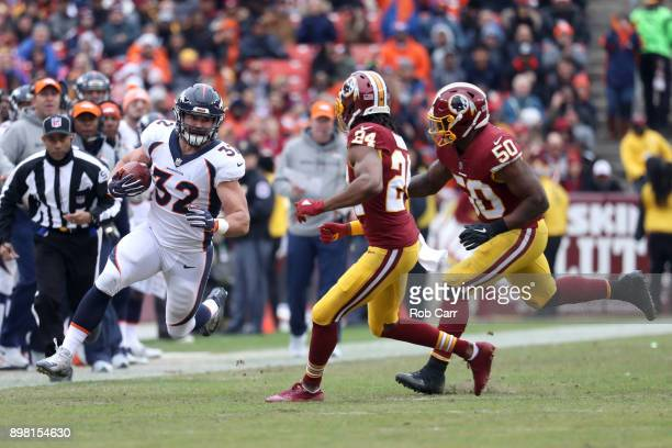 Cornerback Josh Norman and inside linebacker Martrell Spaight of the Washington Redskins move in to tackle fullback Andy Janovich of the Denver...