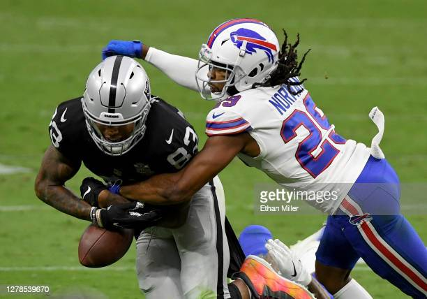 Cornerback Josh Norman of the Buffalo Bills knocks the ball away from tight end Darren Waller of the Las Vegas Raiders during the second half of the...