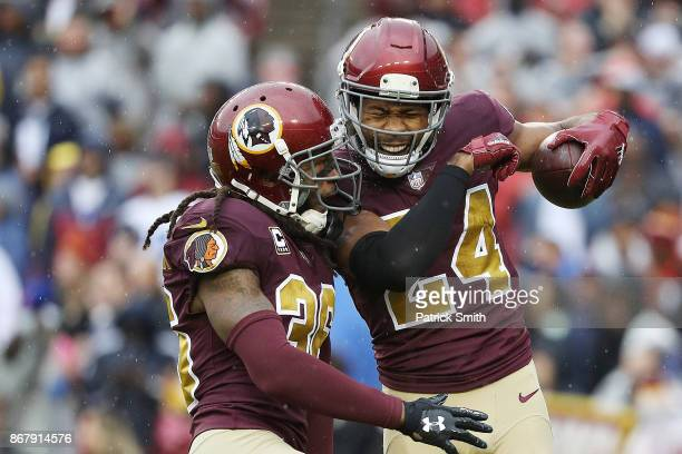 Cornerback Josh Norman of the Washington Redskins celebrates with free safety DJ Swearinger of the Washington Redskins after recovering a fumble...