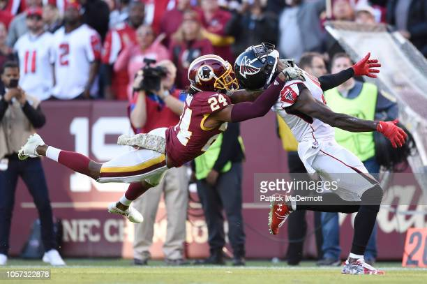 Cornerback Josh Norman of the Washington Redskins is called for pass interference against wide receiver Julio Jones of the Atlanta Falcons in the...