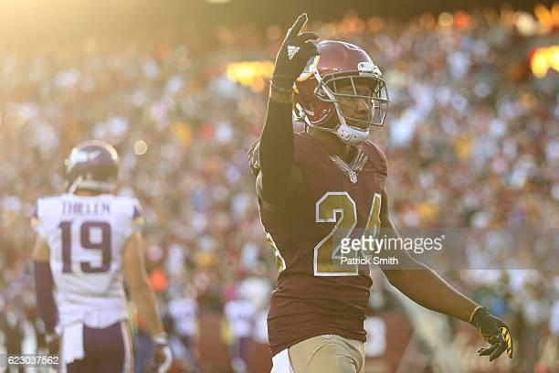 Cornerback Josh Norman of the Washington Redskins reacts after teammate outside linebacker Preston Smith sacked quarterback Sam Bradford of the...