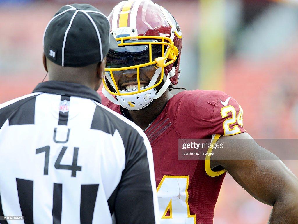 a8c8c13cbed Cornerback Josh Norman of the Washington Redskins talks with umpire ...