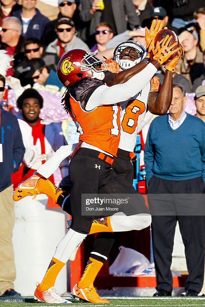 USC Cornerback Josh Shaw #16 of the North Team breaks up a pass intended for Auburn Wide Receiver Sammie Coates #18 of the South Team during the 2015 Resse's Senior Bowl at Ladd-Peebles Stadium on January 24, 2015 in Mobile, Alabama. The North defeated the South 34-13.
