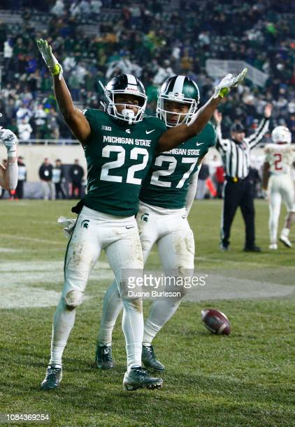 Cornerback Josiah Scott of the Michigan State Spartans celebrates with safety Khari Willis of the Michigan State Spartans after intercepting a pass...