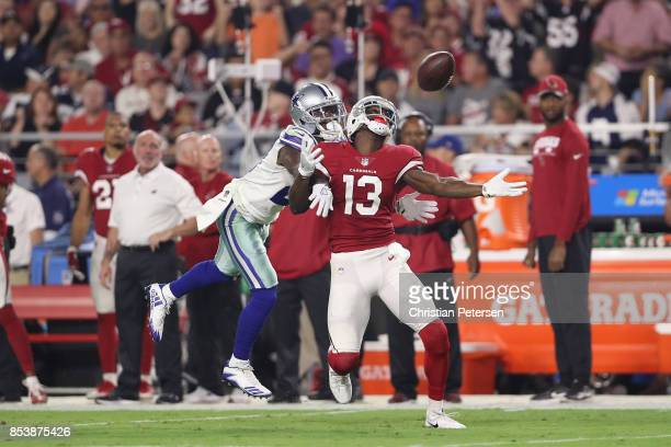 Cornerback Jourdan Lewis of the Dallas Cowboys hits wide receiver Jaron Brown of the Arizona Cardinals during the second half of the NFL game at the...