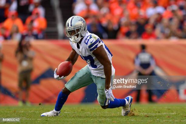 Cornerback Jourdan Lewis of the Dallas Cowboys runs after a fourth quarter interception against the Denver Broncos at Sports Authority Field at Mile...