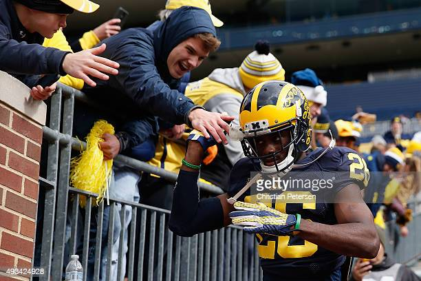 Cornerback Jourdan Lewis of the Michigan Wolverines takes the field before the college football game against the Michigan State Spartans at Michigan...